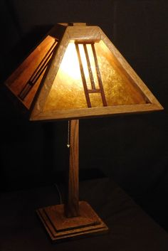 Arts and Crafts desk lamp. Done in white oak, light espresso stain and shellac. High quality brass hardware and with an amber mica shade.  This lamp sells for around $235 on my website and is shipped free with continental US.