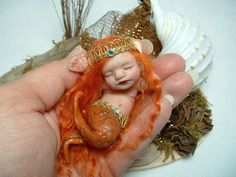 Custom OOAK Hand Sculpted Miniature Mermaid Baby  by LaurieAnnGray, $45.00  I'm not a doll person... just not. But this is quite possibly the cutest little twee creature ever! And so inexpensive! Amazing gift!
