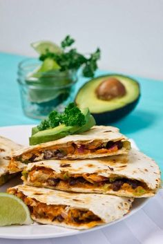 Quesadillas - flour tortillas, black beans, chipotle hummus, tomato, onion, scallion, cilantro, and avocado. CHIPOTLE HUMMUS sounds particularly intriguing!