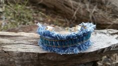 Check out this item in my Etsy shop https://www.etsy.com/listing/499431137/denim-cuff-bracelet-with-aqua-blue-bugle
