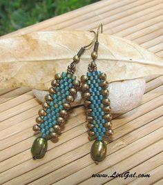 Dragon Skin. Delica Earrings in Green and Bronze. $15.00, via Etsy.