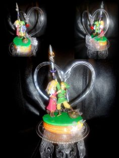 Amazon.com: Nintendo The Legend of ZELDA WEDDING CAKE TOPPER: Everything Else (I would personally like their loftwings instead of the silver thing but hey)