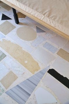 A close-up of the marble floor they ultimately designed.