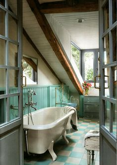 Love the sloped clapboard ceiling.