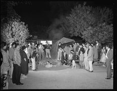 Title:  Chavez Ravine residents confer with Councilman Roybal after eviction  Camping out--Councilman Roybal, center, confers with members of Arechiga family who are camping out near their home, from which they were evicted before it was razed to make room for ball park  Creator/Contributor:  Anonymous, Photographer  Los Angeles Times (Firm), Publisher  Date:  May 9, 1959  Contributing Institution:  UCLA, Special Collections, Young (Charles E.) Research Library