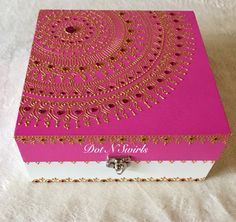 This is the listing of fuchsia and white color wooden box decorated with gold henna mandala and fuchsia color rhinestones. Create the perfect mood for every festive occasion with this stunning box.Celebrate your taste and your style and use it in its original simple elegance or decorate it to fit any occasion or mood. You can also use it to create a one-of-a-kind centerpiece, Truly a must have item for indian/pakistani themed wedding decor - use it as a decorative mehndi plate accessory ...