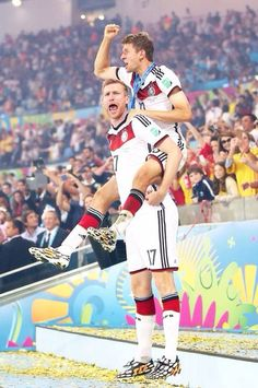 Per Mertesacker and Thomas Muller