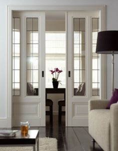 Pocket Doors with Windows. Keep the noise out but let some light shine through without sacrificing valuable square footage.