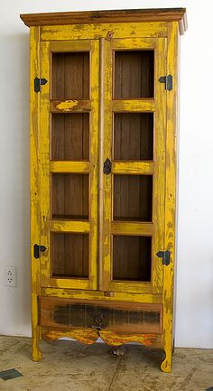 Vintage wooden yellow cabinet. Red or green would be pretty too!