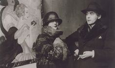 Gerda and Einar Wegener in front of Gerda's painting Sur la route d'Anacapri at an exhibition in 1924