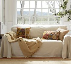 Pottery Barn loose dropcloth slipcover...can't decide whether I like this look or not.