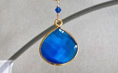 """Baby Blue Handcrafted Hydroquartz Necklace. If you could see the iridescence in person you'd fall for this amazing gemstone immediately! Roughly the size of a quarter. Set in vermeil and hand wire wrapped with 14K gold filled wire to a matching Swarovski crystal and 18"""" 14K gold filled chain. Handcrafted with love."""