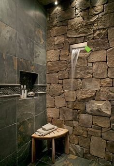 Hastings waterfall shower head --Like this waterfall fixture!  And I like the slate wall, inset, and accent.