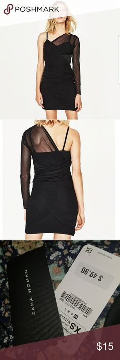 Black one shoulder dress Black one shoulder mini dress with sheer overlay. One of those dresses that look awesome on Zara Dresses One Shoulder