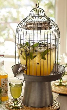 Beautiful birdcage beverage dispenser http://rstyle.me/n/ec3ufnyg6