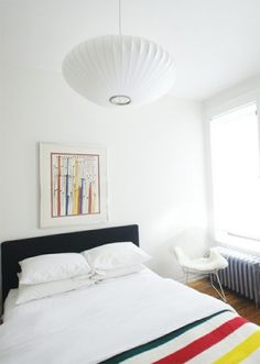 Modern bedroom with HBC blanket and nelson pendant.