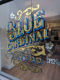 Gold leaf window sign by Paul Banks Signs for Blue Cardinal Tattoo. matt and bright gold leaf, white gold leaf, variegated leaf, blended shades and mother of pearl inlays. All work done on site. Painted Letters, Hand Painted Signs, Tattoo Shop Decor, Cardinal Tattoos, Sign Writer, Show Logo, Tattoo Signs, Tattoo Fonts, Window Signs
