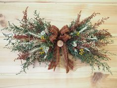 Small Rustic DRIED FLOWER Swag - Perfect Farmhouse Decor. $22.00, via Etsy.