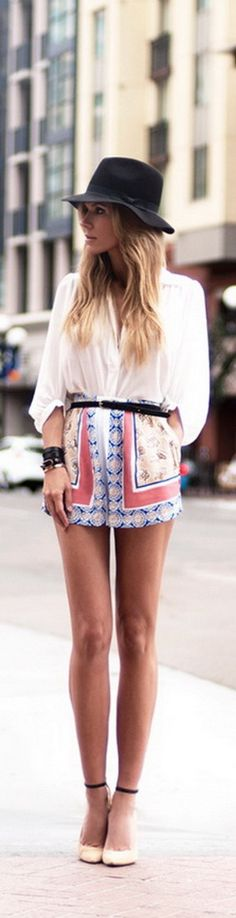 patterned shorts, white blouse, hat