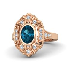 Vintage-inspired Oval London Blue Topaz 14K Rose Gold Ring surrounded with Diamonds - Arya Ring | Gemvara