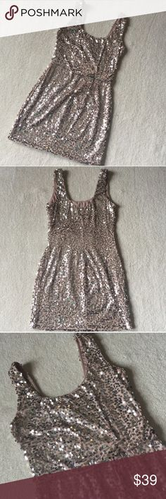 """Blush Pink and Silver Sequin Cocktail Dress Love Reign cocktail dress. Twist accent at the waist. A couple of small snags in the threading for the sequins hardly noticeable. Size Medium. Has a decent amount of stretch, very comfortable. 93% Polyester 7% Spandex Length 32.5"""" Bust 31"""" Waist 26"""" 38"""" Love Reign  Dresses"""