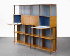 Custom-made bookshelf in caviona wood. Designed by Joaquim Tenreiro for a private commission in the Flamengo neighborhood of Rio de Janeiro, Brazil, Vintage Furniture, Home Furniture, Furniture Design, Furniture Storage, Furniture Dolly, Furniture Ideas, Bauhaus, Modern Bookcase, Mid Century Modern Furniture