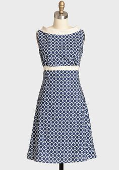 Rendered in lightweight breezy cotton, this playful navy dress by Heartbreaker boasts an ivory geometric print, a classic A-line silhouette, and waist-defining ties for a defined fit.