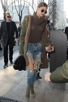 Gigi Hadid wearing Oliver Peoples The Row After Midnight Sunglasses, Versace Ryder Bag, Gucci Blooms Iphone Case, One Teaspoon Saints Jeans in Heartland, Oscar Tiye Samira Lace-Up Suede Boots and Mr&Mrs Italy Pre-Fall 2017
