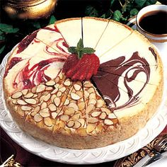 """Make """"wedding cake"""" cheesecake for display. Have separate cheesecakes for guests. Bring them out after the 'cake cutting'."""