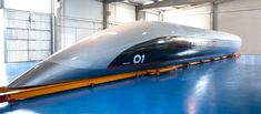 Hyperloop Transportation Technologies has unveiled a prototype of a full-scale passenger Hyperloop capsule designed by Priestmangoode.