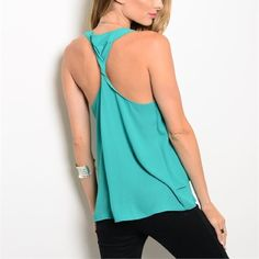 Lovely in green! Twist back tank! Two tired pretty green tank with a twist back! Lovely! Tops Tank Tops