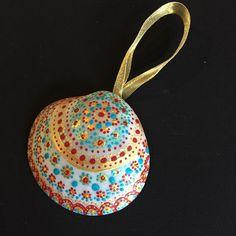 Hand Painted Shell Christmas Ornaments #seashells #paintedshells #seashellornaments #islandliving #islandwedding #coastaldecor #coastalhome #nautical
