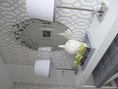 Grey and white trellis wallpaper foyer. I like this wallpaper, but for my 1/2 bath