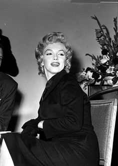 """Marilyn Monroe at a Press Conference at the Savoy Hotel in London to publicize her forthcoming film """"The Prince And The Showgirl"""", 1956."""