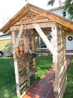 $18; I made this little shack as an entrance up our walkway.  I bought 6 pallets ( I asked for the most used, beat up, ugliest looking pallets) at $3 a piece.  I actually could have gotten them free on Craigslist if I could have been patient enough.  I used 4 for the sides and tore two apart for the roof.