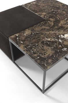 When opposites come together in perfect harmony: a soft ottoman blends the clanging of metal and the sophistication of m ...