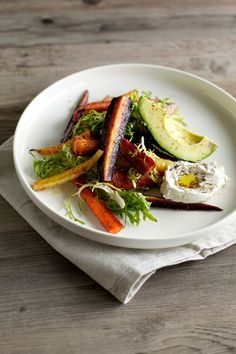 za'atar roasted carrot salad with cashew labneh, avocado & frisée. Vegan Raw