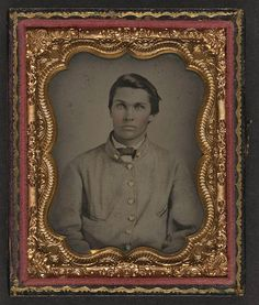 [Unidentified young soldier in Confederate sack coat] (LOC)    [Unidentified young soldier in Confederate sack coat]    [between 1861 and 1865]    1 photograph : ninth-plate ambrotype, hand-colored ; 7.3 x 6.2 cm (case)