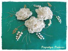 White ribbon flowers on turquoise background