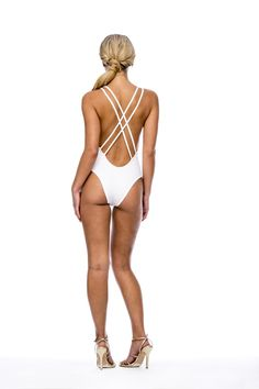 Peixoto Swim White Malaka Swimsuit  A bright white one piece swimsuit looks amazing on tan skin, and this Summer there are many stylish one piece options. The stylish Miami based brand, Peixotowear is known for their unique one piece swimwear. The Peixoto Malaka One Piece in White is seriously sassy open back swimsuit with a plunging V neckline. The removable soft padded cups and lining help to keep you covered up and comfortable. #onepiece