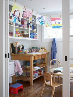This adorable kids' crafts room is well-stocked with plenty of art supplies. A utility sink allows kids to clean up after messy art projects. A laundry line hangs across the room to display masterpieces. Hard-surface flooring in a kids' craft room is essential for easy cleanup.