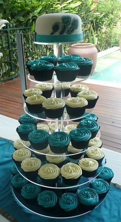 alexia dives posted Peacock Cupcake Tower to their -wedding cakes- postboard via the Juxtapost bookmarklet. Fondant Cupcakes, Peacock Cupcakes, Peacock Cake, Peacock Theme, Wedding Cakes With Cupcakes, Cupcake Cakes, Teal Cupcakes, Cupcake Tier, Peacock Wedding Cake