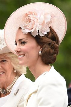 Duchess Of Cambridge: Hair Style File - June 2016 - She chose a dramatic Philip Treacy hat and a side-swept chignon for 2016's Trooping The Colour.