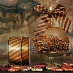 "It's National Caramel Day! We have lots of candy themed ribbons but today we feature our caramel stripes available in 7/8"" and 1.5"" widths! Adding this yummy ribbon to your treats will add to the flavor of the presentation! #nationalcaramelday #caramel #yummy #golden #sweet #gooey #sticky #candy #treats #favors #decoratewithribbon #stripes #satin #ribbon"