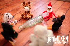 a few elf on the shelf photo ideas.... here's a funny one of elf playing spin the bottle with stuffed animals. LOL