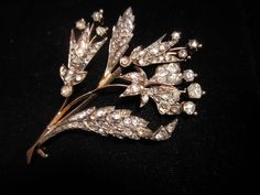 Beautiful rose cut diamonds set in this Georgian brooch.  They are set in silver and gold.  The largest diamond weighs approximately .40 cts.  The