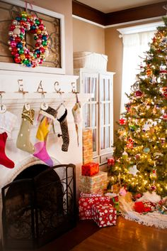 colorful christmas. Love the wreath above the mantel