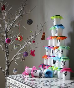 DIY Advent Calendar made from empty cans or jars.