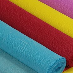 Crepe paper rolls to hang from the ceiling in your wedding colors!