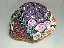 handpaintedrocks.net  I painted this river rock in acrylics.  ('Flower basket'-painted on all sides)
